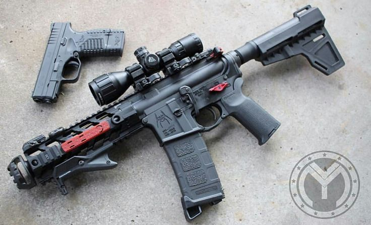 AR-15 with scope, magpul furniture, and angled forehand grip  Glock ?