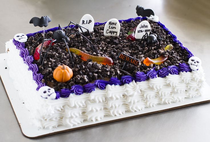 a graveyard sheet cake with worms and spiders   halloween