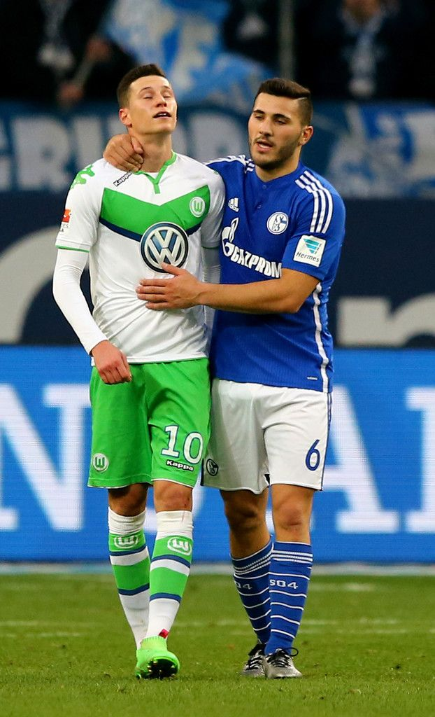 Julian Draxler Photos Photos - Sead Kolasinac of Schalke comforts Julian Draxler of Wolfsburg during the Bundesliga match between FC Schalke 04 and VfL Wolfsburg at Veltins-Arena on February 6, 2016 in Gelsenkirchen, Germany. - FC Schalke 04 v VfL Wolfsburg - Bundesliga