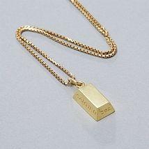 Cartier, hänge i form av guldtacka. Stadsauktion. EST: 6 500 SEK. Barnebys.se