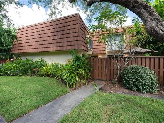 Come home to this charming 2 BR 2 BA garden townhome in the heart of Fort Myers. Once you enter the gate of your private and spacious fenced courtyard oasis surrounded by mature trees and lush flowering tropical greenery its so easy to forget how close you are to shopping dining schools beaches and downtown excitement This popular yet peaceful community includes a heated community pool for year-round enjoyment and nearby trails for biking walking and jogging add to the pleasant lifestyle…