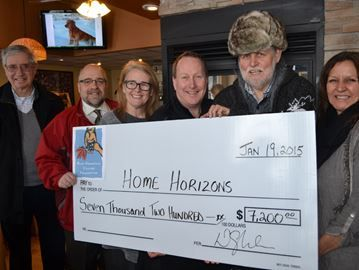 Donation to Home Horizon - George Weider, Troy Speck, Stacy Manning and Bruce Melhuish representing the Blue Mountain Village Foundation presented a cheque for $7,200 to Home Horizon, represented by John Devries and Doris Sensenberger on Monday.