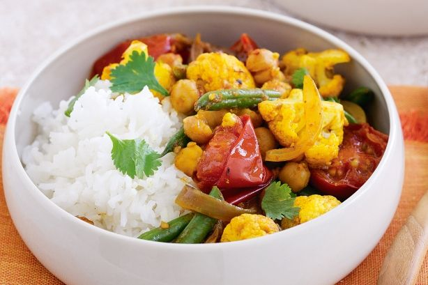 Looking for interesting, healthy ways to increase your vegie intake? Do it Indian style with this bright and spicy meal. Spring vegies and stir-fried spices give this low-fat curry loads of flavour.