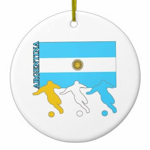 Argentina Soccer Players Double-Sided Ceramic Round Christmas Ornament http://www.zazzle.com/argentina_soccer_players_double_sided_ceramic_round_christmas_ornament-175377523499497811?rf=238756979555966366&tc=PtMPrssLaOrnament Three soccer players play in front of the Argentinian flag.   Country name Argentina is on the side