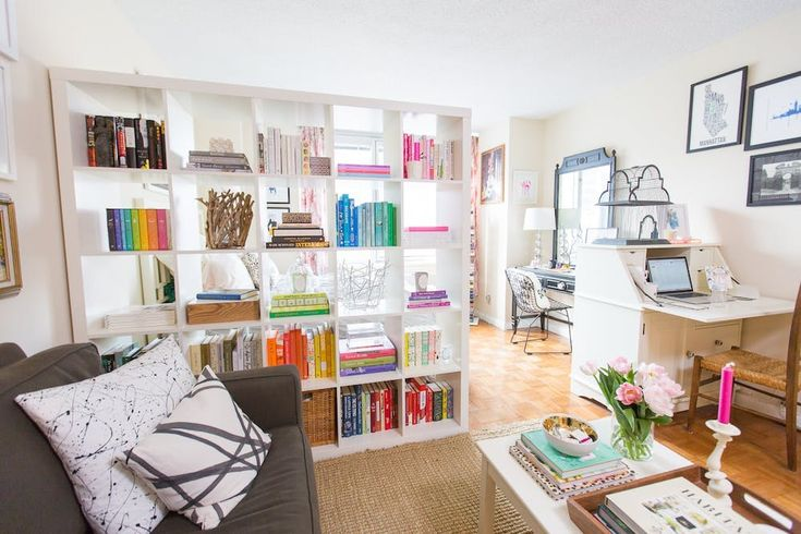 With color-coordinated shelves, a room-dividing piece becomes an instant focal point.