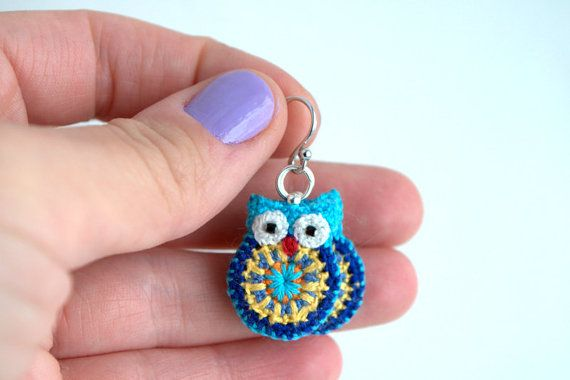 Crocheted Owl Earrings made with embroidery thread and black beads for eyes