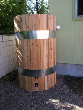 custom cedar fitting to the exterior of rain tank to help it blend in with the rest of the outdoor decor