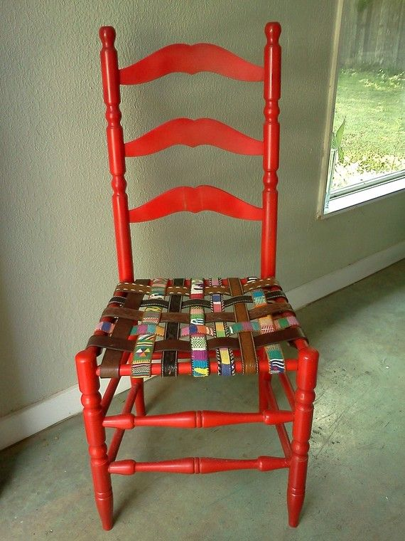 The tattered cane seat of this old wooden chair was removed and replaced with belts. Isn't it fantastic? 