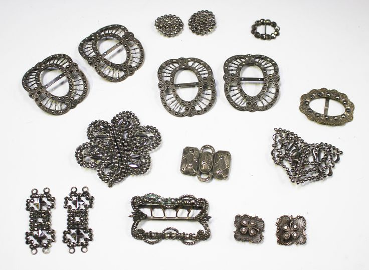 Two pairs of 19th century cut steel shoe buckles, each of pierced scroll outline, length 6cm, tog