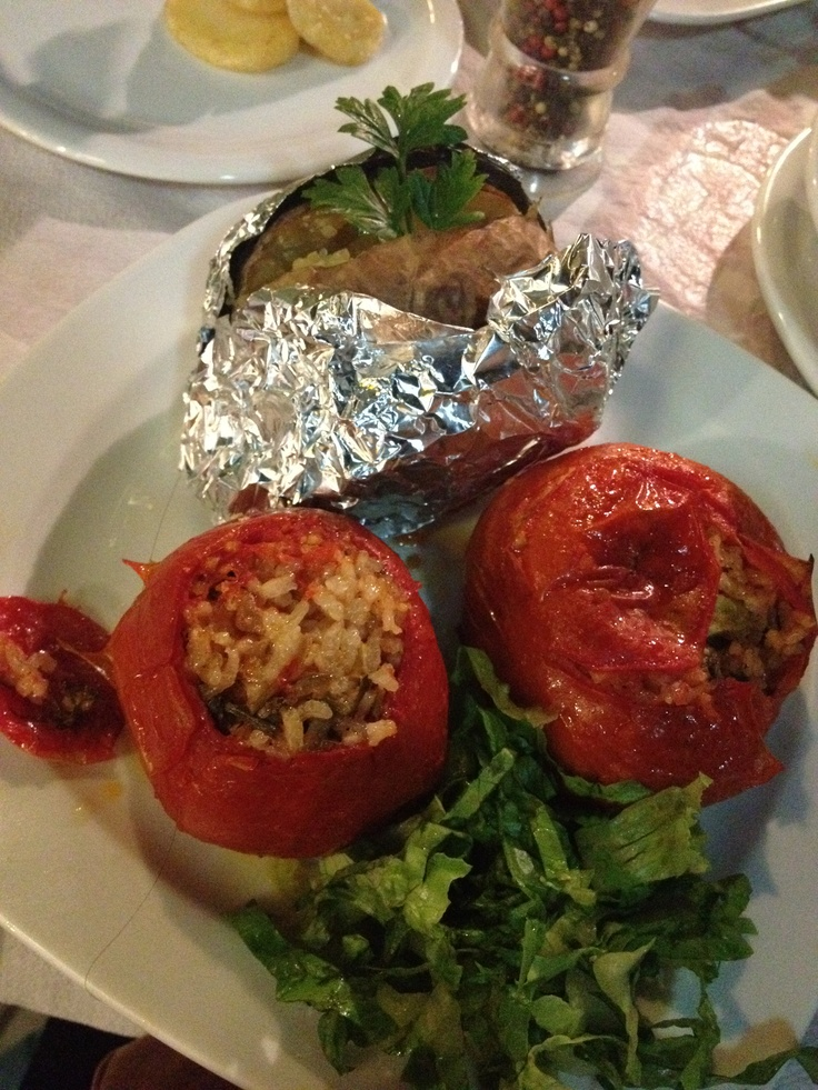 Greek stuffed tomatoes and a baked potato at Scirocco Restaurant in Naxos Island, Greece