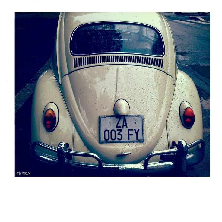 Classic VW bug with Italian license plates. Photo by Johannes Beilharz.