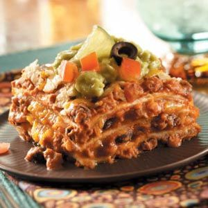 Favorite Mexican Lasagna:Tortillas replace lasagna noodles in this beefy casserole with a south-of-the-border twist. With salsa, enchilada sauce, chilies, cheese and refried beans, it's a fiesta of flavors. http://www.tasteofhome.com/Recipes/Favorite-Mexican-Lasagna