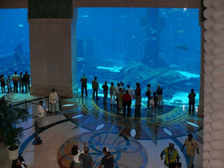 Aquarium lobby of atlantis hotel in dubai places to go for Fish hotel tank
