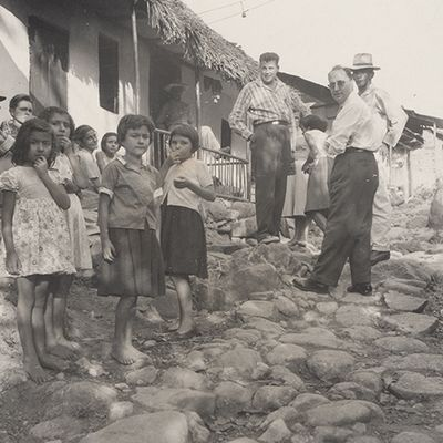 Hector Abad Gomez (right) with the inhabitants of a rural community, 1961