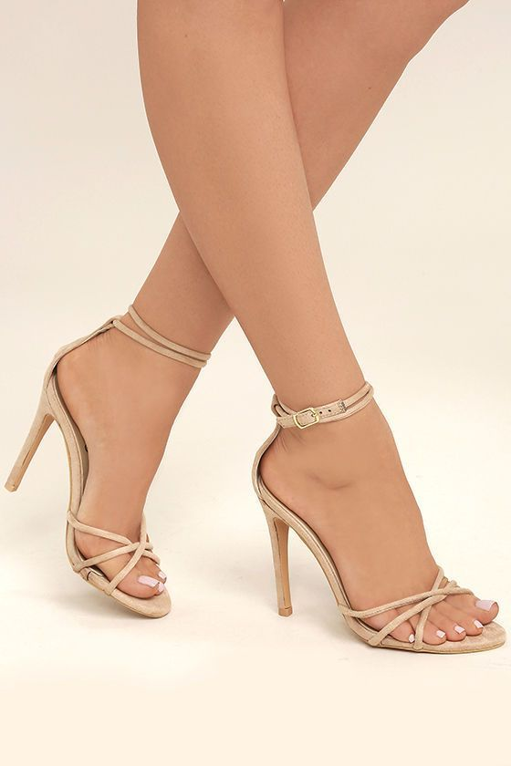 Dominate the evening scene in the Damita Nude Suede Ankle Strap Heels! Rounded vegan suede straps cross over a peep-toe upper, while an extra long ankle strap wrap and secures with a gold buckle.