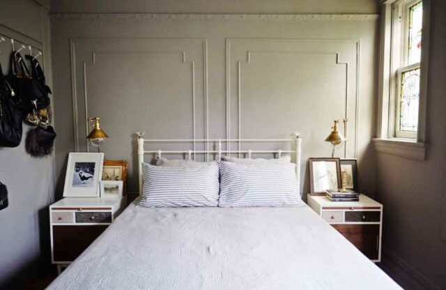 Lovely bedroom. I particularly like the lamps and the detail on the wall - a clever trick.