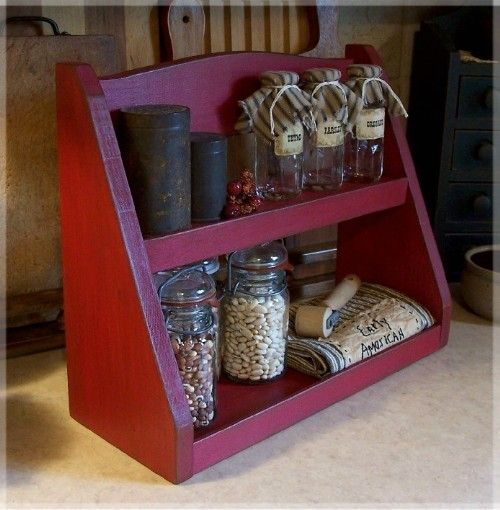 I'd use this for tea stuff.    Primitive Step Back Spice Rack / Farmhouse Kitchen by Sawdusty, $45.00