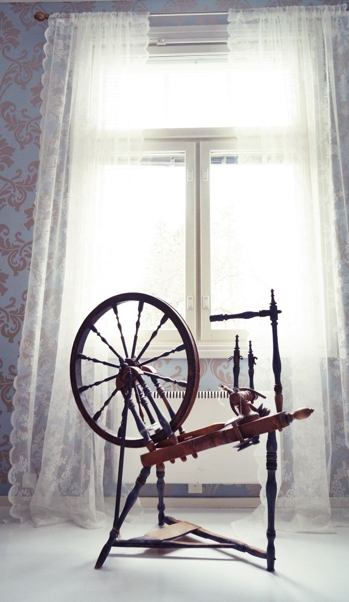 My old spinning wheel & lace curtains