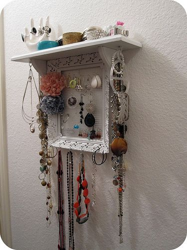 Such a pretty jewelry display!  I love the frame and shelf so you can store all of it in one place.
