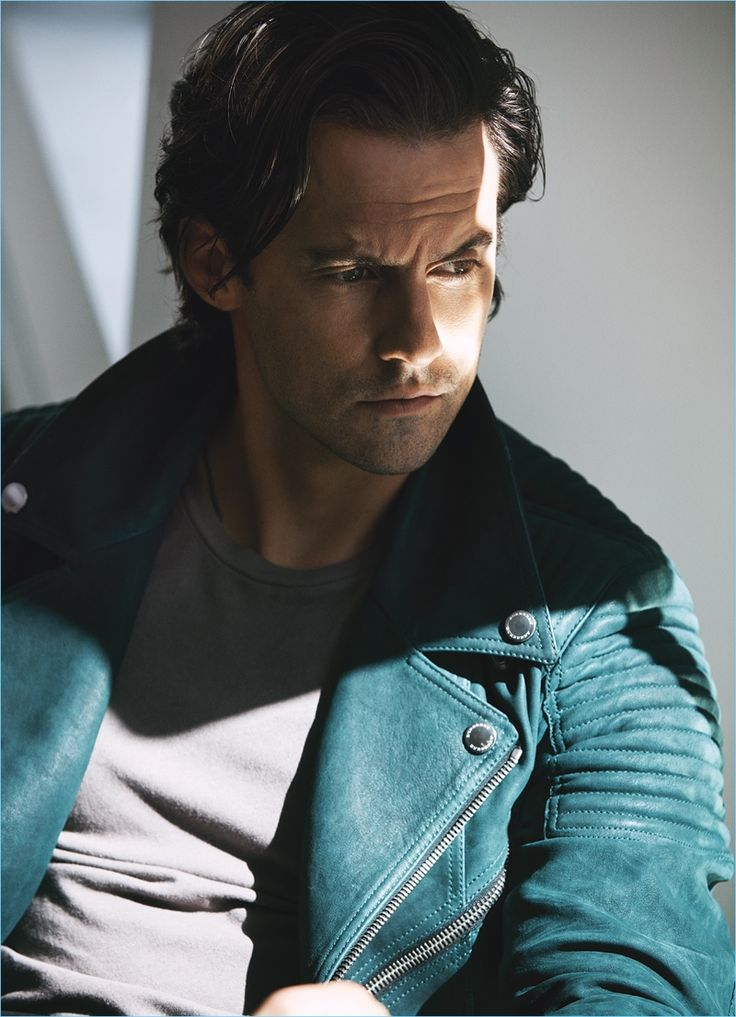 Starring in a photo shoot, Milo Ventimiglia sports a suede Burberry jacket with a Kenneth Cole t-shirt.