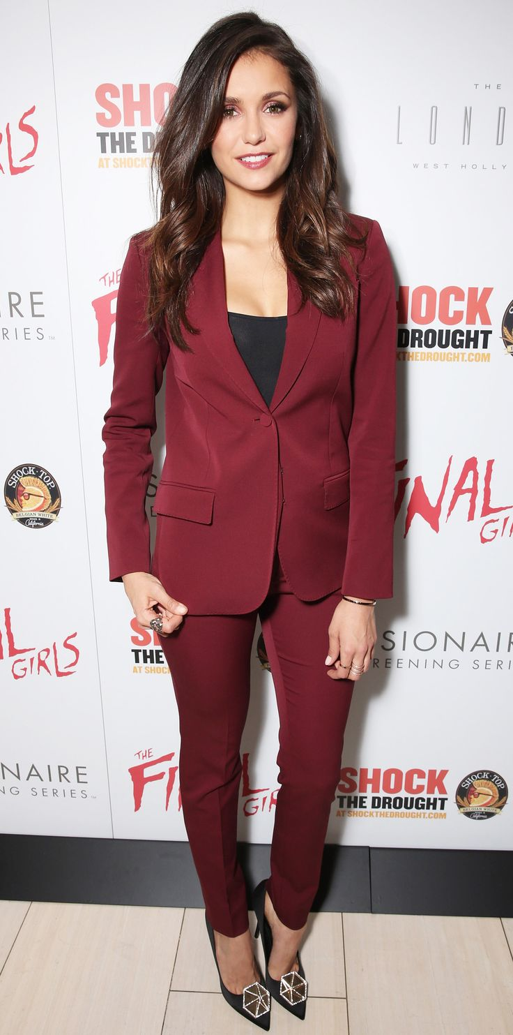Nina Dobrev suited up for the premiere of The Final Girls in wine-hued suit separates that was styled with a black layer, a selection of rings, and pumps accented with a gilded geometric disk.