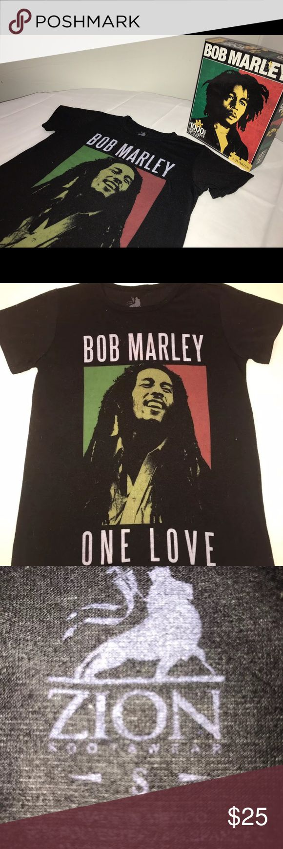 """BOB MARLEY #1 FAN t shirt & puzzle Like new black BOB MARLEY t - Shirt by ZION for ladies size small. Measurements- 17"""" across Length top to bottom- 23"""" Soft cotton blend SmallAquarius Bob Marley One Love 1000 Piece Puzzle Features:  1000 Pieces Measures 20 x 27 when completed Full color with snug fitting pieces bob marley Tops Tees - Short Sleeve"""