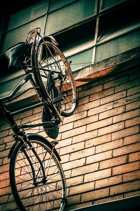 Melbourne Photography - Bike Mounted on top of a bar / restaurant entrance down a lane way of the Paris end of Collins Street