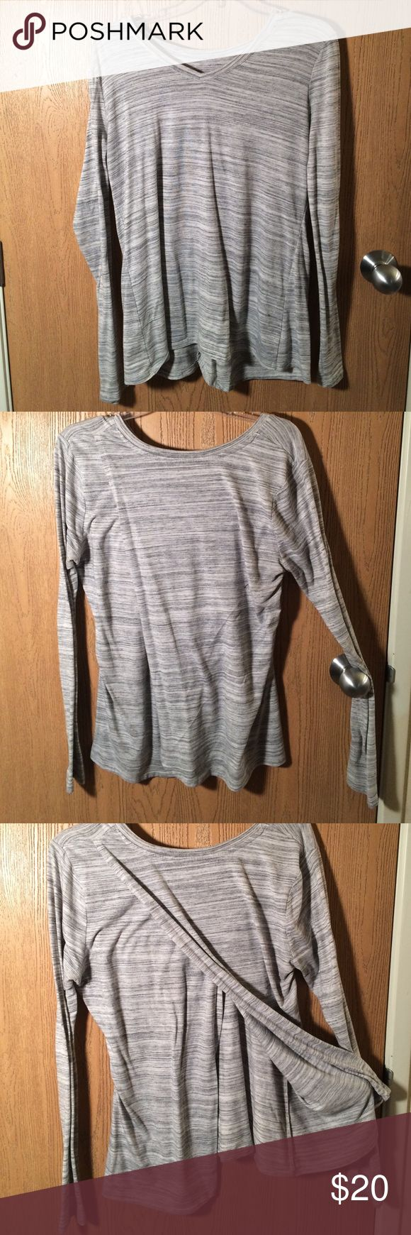 Tulip back long sleeve shirt Tulip back heather grey shirt. Long sleeves and warm bud open back allows for air while working out. Also very easy to transition to day to day Athleta Tops Tees - Long Sleeve