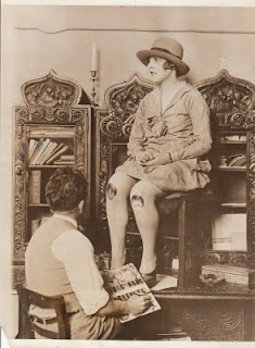 "'A fashion due for a return...The Painted Knee. Shown here is ""Gina"" a Moulin Rouge Dancer and one of the first to adopt the latest fad. Ornamental colored faces painted on the knees. The paintings are placed so the figures perform amusing dances or contortions when the owner walks or flexes.    Original Press Photograph Dated 1926 Collection Jim Linderman': Rouge Dancers, Red Mill, Beautiful Bizarre, Hats Vintage, Vintage Photography, Dancers Paintings, Paintings Stockings, Paintings Tattoo, Press Photographers"