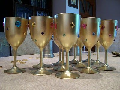 "spraypaint plastic glasses and glue stones on for ""goblets"""
