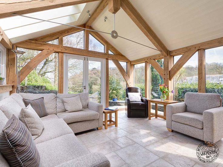 Glazed Gable and Contemporary Stainless Steel and Oak Truss in Oak Framed Extension in Devon by Carpenter Oak Ltd
