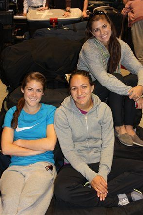 Kelley O'Hara, Stephanie Cox and Alex Morgan traveling to Florida training camp.