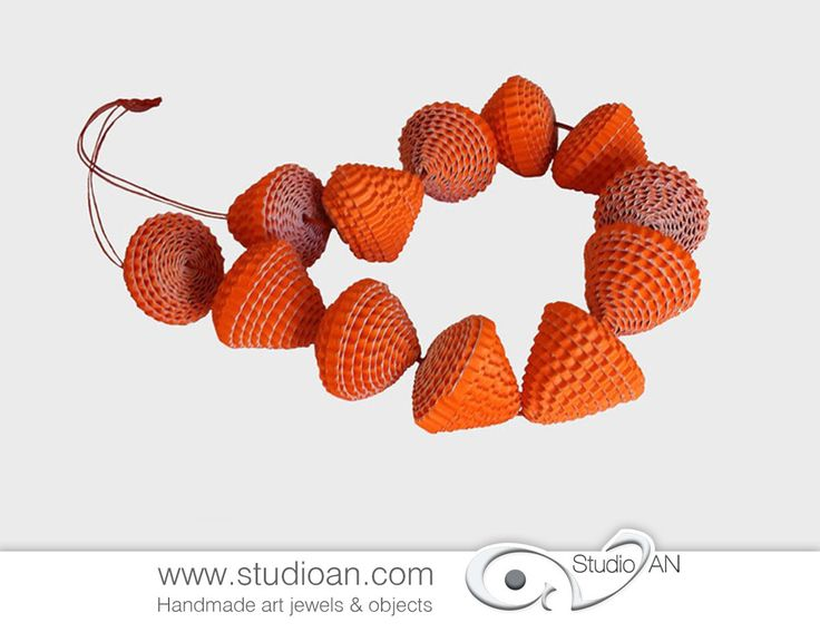 Necklace made of big orange paper beads http://www.studioan.com