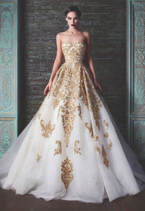 Beautiful gold embellished white ball gown