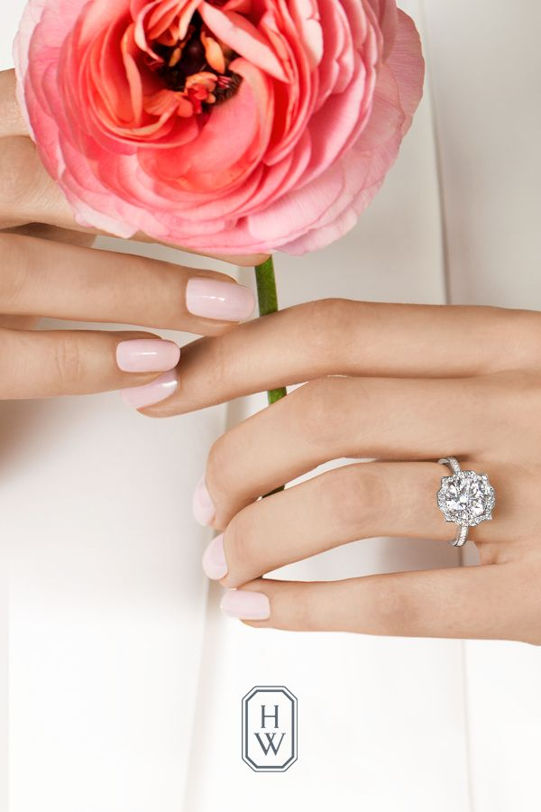 Fall brilliantly in love with the Harry Winston Belle engagement ring that marks the marriage of charming style and state-of-the-art diamond cutting with a Deco-inspired design that is as memorable as your love. Shop Harry Winston engagement rings and fall in love.