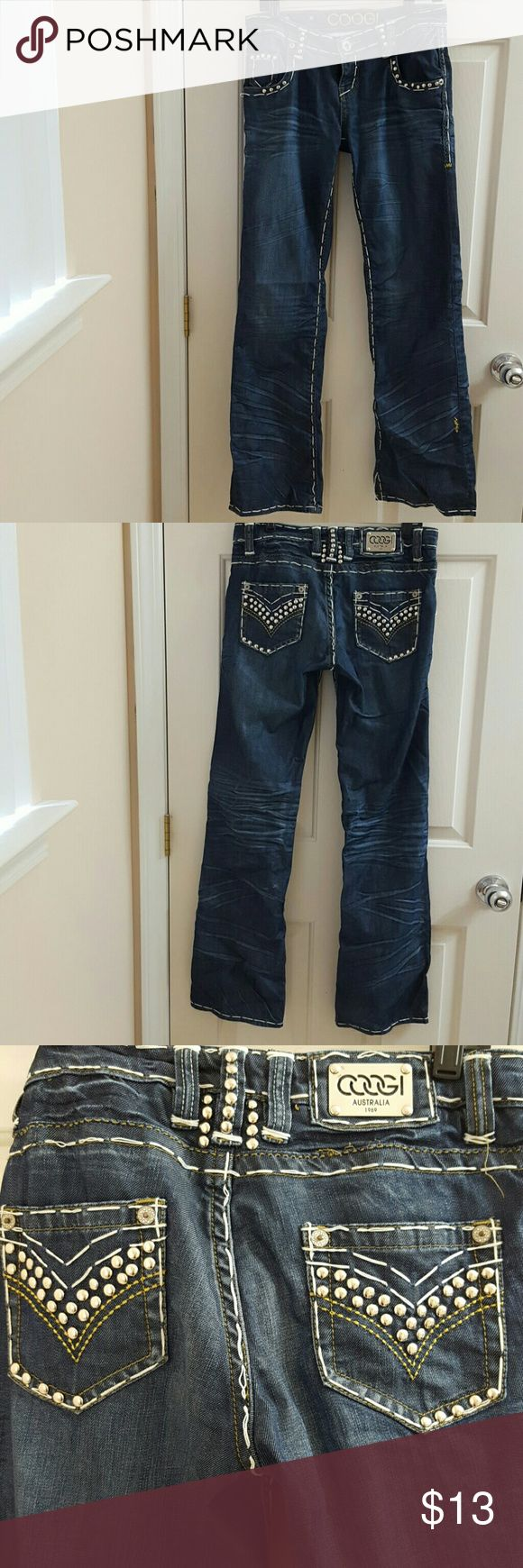 Coogi jeans Dark wash with some lighter detailing. Funky silver detail. Nice white stitching. Note: in picture #4 the stiching came out. Can sew back in if you are talented in that way, which I Am Not. Lol COOGI Pants Boot Cut & Flare