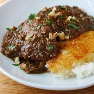 Khoresht-e Fesenjan -- Persian chicken stew with walnut and pomegranate.