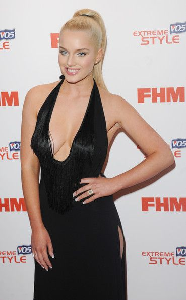 Helen Flanagan Lookbook: Helen Flanagan wearing Halter Dress (5 of 7). Helen Flanagan chose a super sexy red carpet look when she chose this V-neck gown with a fringe detailed neckline and a side slit.