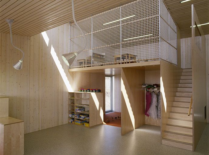 Kindergarten Neumarkt by Schneider and Lengauer - uses natural wood and a mesh mezzanine or loft space.