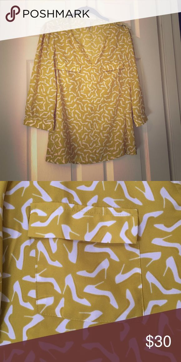 Mustard shoe print blouse This blouse is perfect for work. It has a fun print and beautiful mustard color that stands out from every day blouses. Sleeves are 3/4 length. Banana Republic Tops Blouses