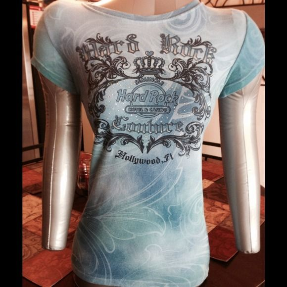 HP 2/15 & 10/17HARD ROCK COUTURE T SHIRT LIMITED EDITION HARD ROCK COUTURE T SHIRT! Light blues and teal print with S Crystals. Purchased at the Hard Rock Resort and Casino in Hollywood, FL 95% Cotton 5% Spandex. Size XS. NWOT 2XHP 2/15 10/17 Hard Rock Couture  Tops Tees - Short Sleeve