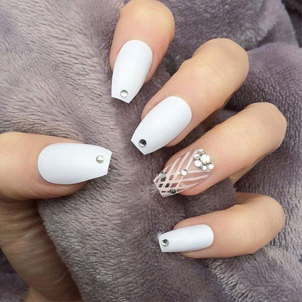 False nails will make it easier for you to achieve the design and the shape that you are looking for. Here it's a simple matte white nail with diamond for accent. But the main event is the transparent falsies with white stripes and diamonds.