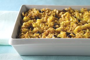This sweet version of baked noodle pudding with raisins and cinnamon-sugared corn flake topping is served warm for dessert during the holidays. #recipe