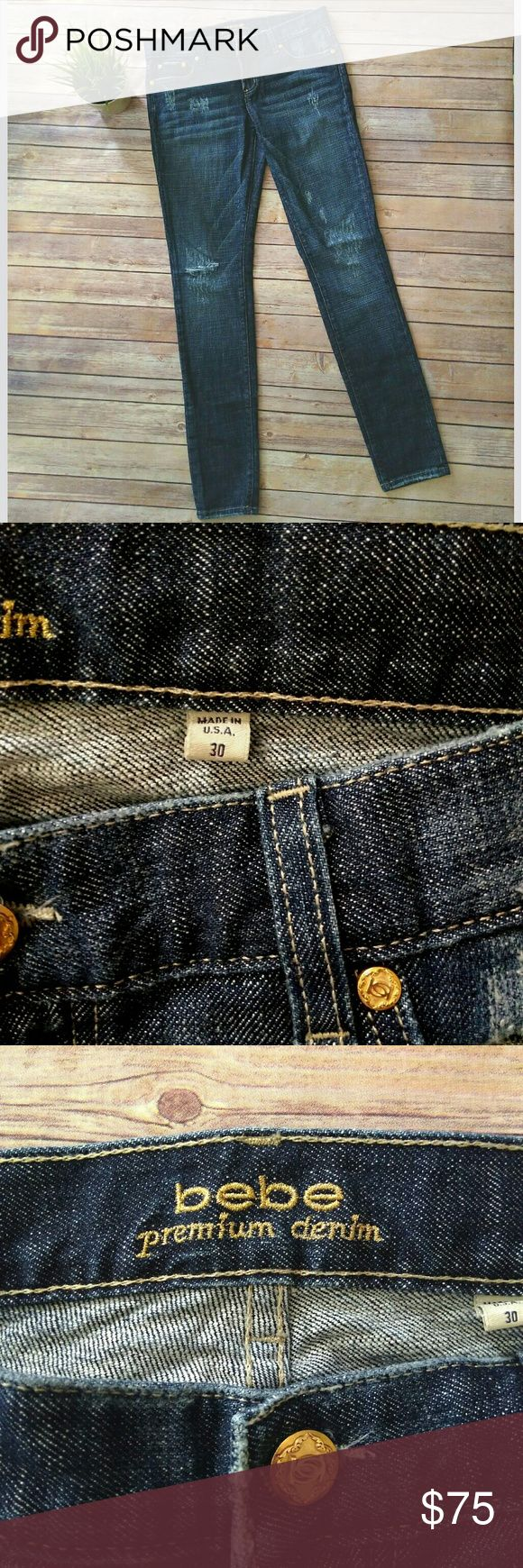 bebe rare Carmen stud  skinny distressed jeans bebe Premium Denim jeans in a dark wash with a distressed look.  The style name is Carmen Double B Stud Skinny.  This is a rare style, hard to find.  It has pink rhinestones on the back pockets (two missing from left pocket). It has gold hardware.  Pet free smoke free home.   Rise: 8.5 inches Inseam: 33 inches Waist: 18 inches laying flat bebe Jeans Skinny