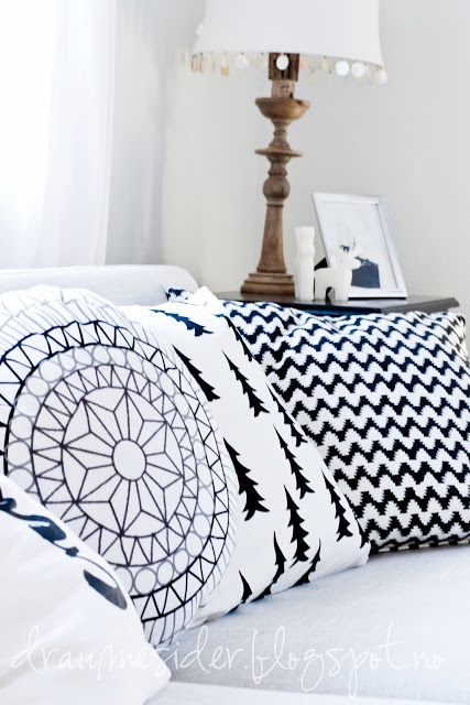 Bedroom Styling: Black and white for cushions and timber and white lamp. You would never get tired of this.