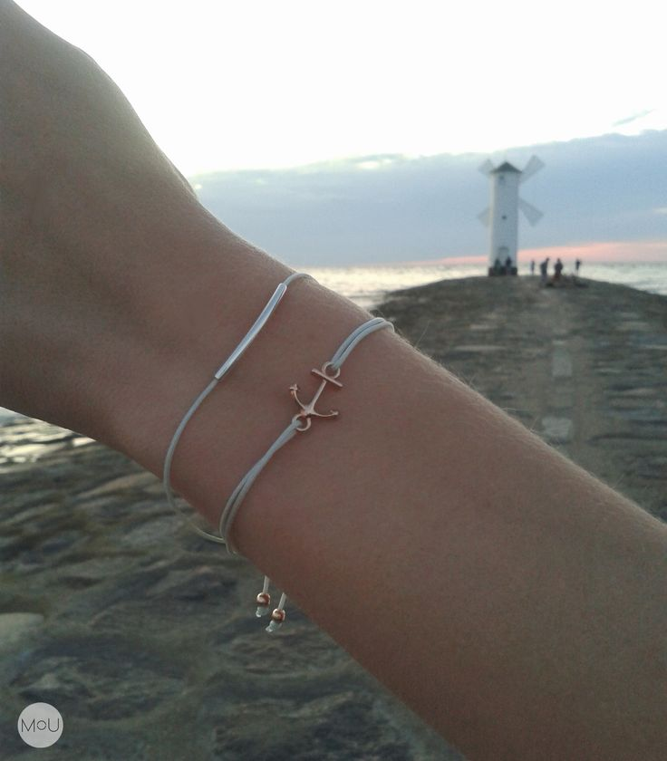Twine bracelets with simple silver pendant and rose gold anchor.