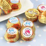 """Belgium chocolate coins are the perfect accent for any baby shower.  Choose from 7 foil colors and personalize your message with many different designs. Each chocolate coin measures 1.5"""" in diameter."""