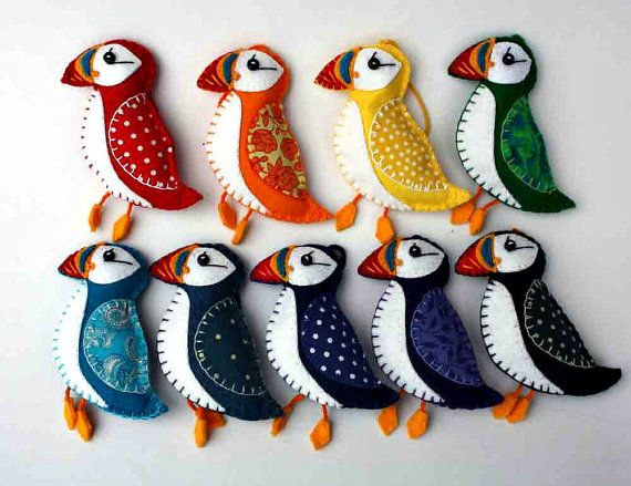 Handmade puffin ornament in a range of bright colours. Hand embroidered and stitched from felt and cotton prints. Each puffin is 3.5 inches (9cm)