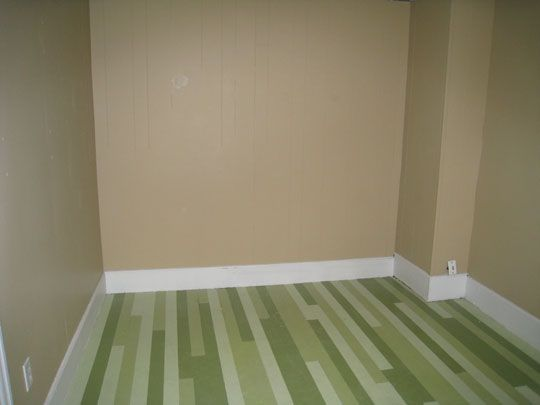 Painted floor with each board individually painted. The colors aren't my thing but its a fun concept.