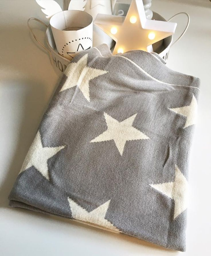 The softest grey star blanket, in the most beautiful quality 100% cotton.  This would make the most adorable baby blanket, but it is also perfect as snugly cuddle up on the sofa blanket.  It measures 90cm x 70cm